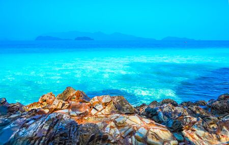 Beach, beautiful panoramic sea view, with clean water, blue sky and some brown rocks. 스톡 콘텐츠