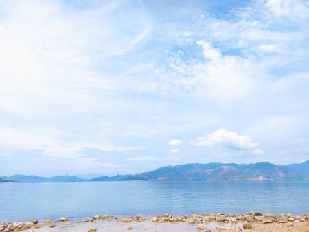 Beautiful panoramic sea and beach view, with clean water, blue sky, clouds. Idyllic cloudscape. Tavel and summer. Natural minimalistic background and texture, web banner