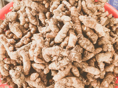 Close-up heap, pile of raw ginger turmeric on a local asia farmers market. Cooking and healthy food concept, vitamins for strong immunity Stok Fotoğraf