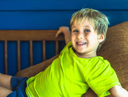 Portrait mischievous cute blond blue eyed boy making freckles face play laughing in happy mood. Funny photo, happiness lifestyle. Daycare, simple joys happy childhood, behaviour education psychology