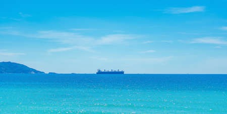 Beauty panorama skyline in pure blue azure sea, clear sky background, empty sea only sailing vessel ship on the skyline horizon. Navy is always on guard even in times of peace. For design wallpaper