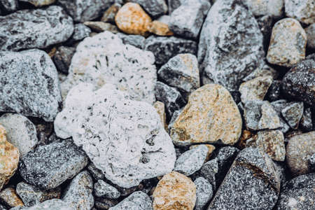Small and big smooth round pebbles, sea dry stones, multicolour gray gravel. Abstract Composition Textured background. Ideal for web banner design