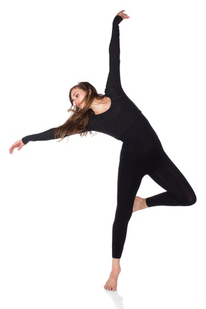 Beautiful slim young female modern jazz contemporary style dancer wearing gym clothes isolated on a white studio background photo
