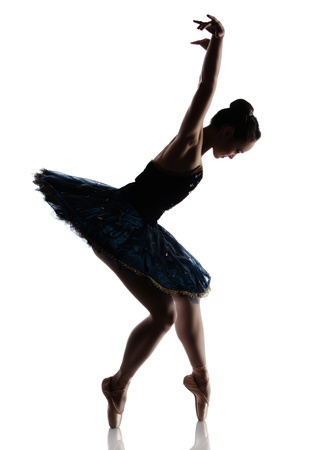 Silhouette of a beautiful female ballet dancer isolated on a white background. Ballerina is wearing a royal blue tutu and pointe shoes. photo