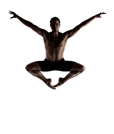 black ski pants: Silhouette of an muscular adult male modern contemporary ballet style dancer  Dancer is wearing black ski pants and is isolated on a white background