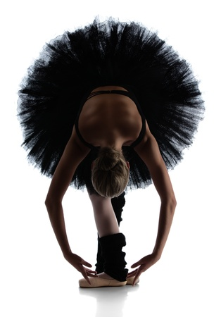 Silhouette of a beautiful female ballet dancer isolated on a white background  Ballerina is wearing a black leotard, black tutu and pointe shoes