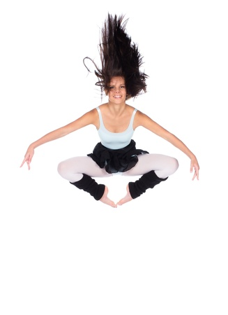leg warmers: Beautiful female modern jazz contemporary style dancer isolated on a white background  Dancer is wearing a blue leotard, black skirt and leg warmers