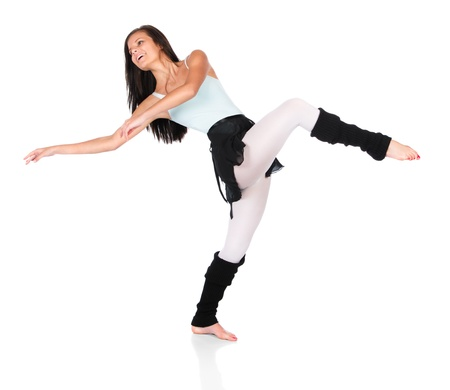 warmers: Beautiful female modern jazz contemporary style dancer isolated on a white background. Dancer is wearing a blue leotard, black skirt and leg warmers.
