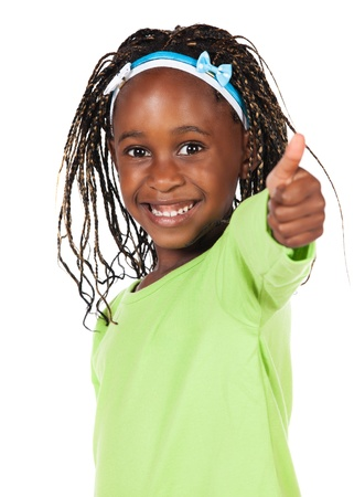 Adorable small african child with braids wearing a bright green shirt. The girl is showing a thumbs up to the camera. photo