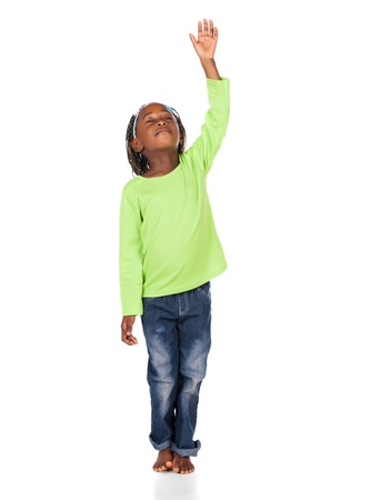worship white: Adorable small african child with braids wearing a bright green shirt and blue jeans. The girl is worshipping with her hand lifted up.