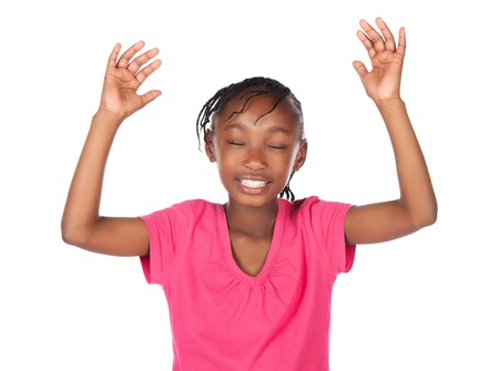 hands lifted up: Adorable small african child with braids wearing a bright pink shirt. The girl is worshipping with her hands lifted up.
