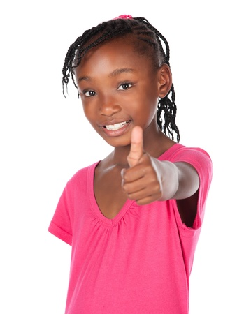 Adorable small african child with braids wearing a bright pink shirt. The girl is showing a thumbs up to the camera. photo