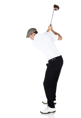 golf swing: Handsome young professional golf player wearing a white shirt and black pants. He is holding and swinging a golf club and looking out. Stock Photo