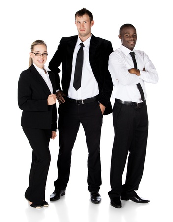 Three young attractive business people, all wearing formal black and white business clothes. Two men and one women are in the team. photo