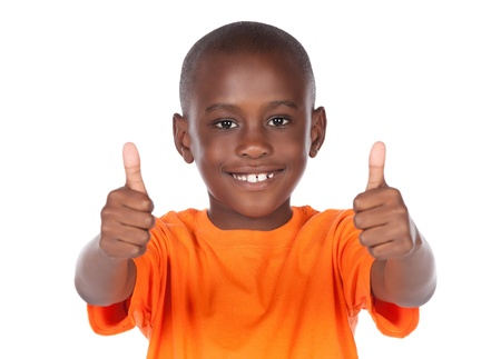 Cute african boy wearing a bright orange t-shirt. The boy is showing a thumbs up to the camera.