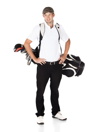 Handsome young professional golf player wearing a white shirt and black pants. He is carrying a golf bag on his back and is smiling. photo