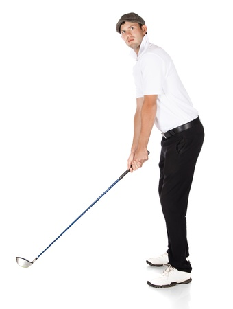 Handsome young professional golf player wearing a white shirt and black pants. He is holding a golf club and preparing for his shot. photo