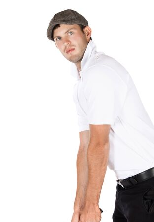 Handsome young professional golf player wearing a white shirt and black pants. photo