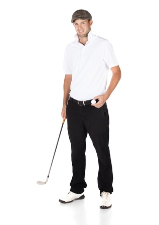 Handsome young professional golf player wearing a white shirt and black pants. He is holding a golf ball and a golf club and smiling at the camera. photo