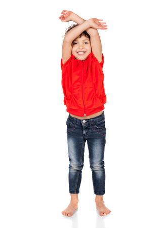 hooded top: Adorable small caucasian child with curly hair wearing a bright red hooded top and blue jeans. The girl is waiving her arms. Stock Photo