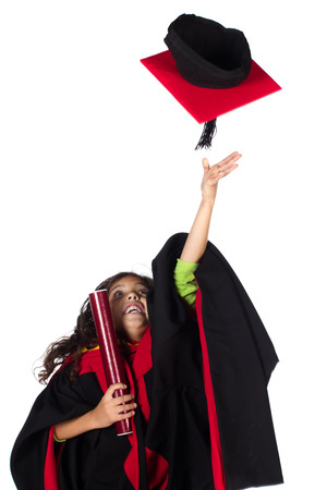 Pretty cute caucasian girl wearing graduation attire and a green long sleeve top. photo