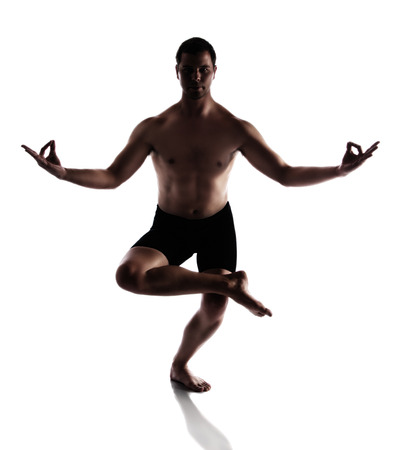 black ski pants: Silhouette of an muscular adult male modern contemporary ballet style dancer. Dancer is wearing black ski pants and is isolated on a white background.
