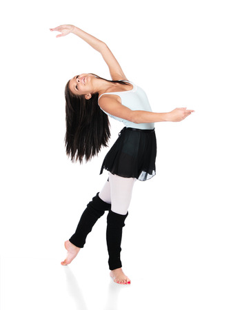 leg warmers: Beautiful female modern jazz contemporary style dancer isolated on a white background. Dancer is wearing a blue leotard, black skirt and leg warmers.