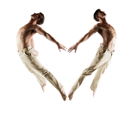 Adult caucasian male dancer wearing beige pants. Image is isolated on a white background. photo