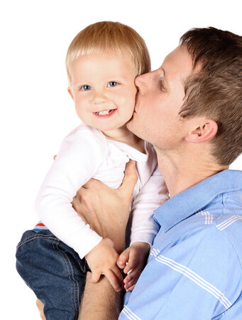 Happy caucasian dad holding and kissing his baby boy. Image is isolated on a white background. Stock Photo