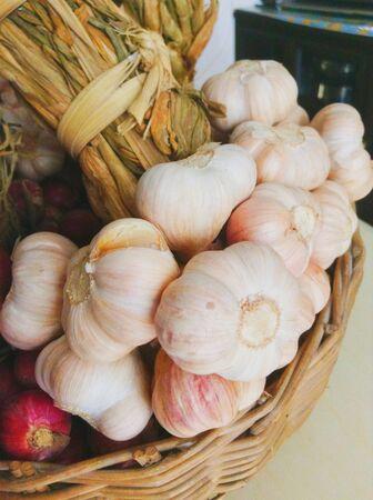 Garlics in basket Stock Photo