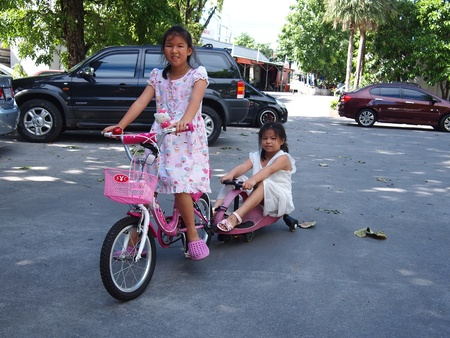Two girls riding bycycle