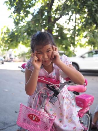Girl play bicycle