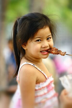 Pretty girl eating grill pork