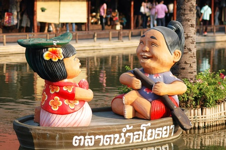 Model of man and women sit on rowboat  Stock Photo