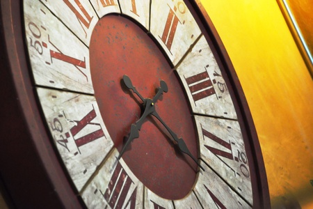 Big old clock hang on yellow wall