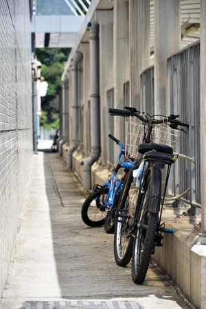Two bicycles park  in narrow lane