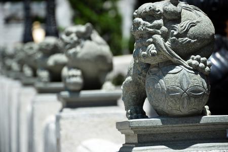 terrify: model of stone monkey on concrete pillar look for terrify.