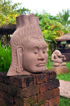 Image head of Buddha on pillar laterite in garden