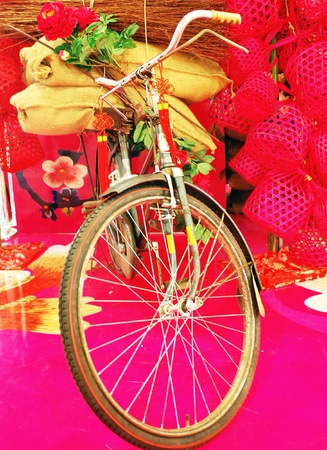 Bicycle transport sacks  branches and red round bamboo baskets