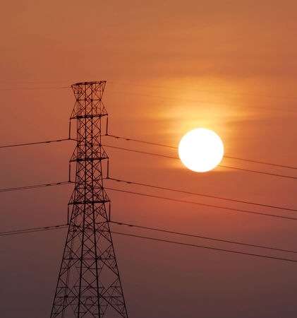 hight tech: silhouette of high voltage electricity post with beautiful sunset background