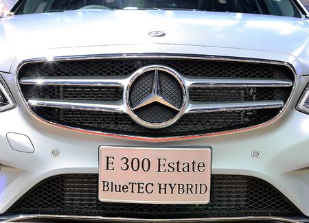 benz: Bangkok - April 2 : close up logo on bumper of Mercedes Benz series E300 estate blue TEC hybrid - in display at The 36th Bangkok international Motor Show 2015 on April 2, 2015 in Bangkok Thailand
