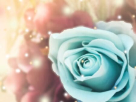 sweet dreamy and de-focused , vintage background  bouquet of blue roses with flare light