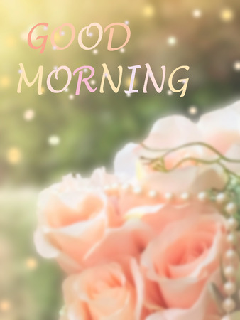 sweet dreamy and de-focused , Good morning word on vintage background  bouquet of pink roses with flare light