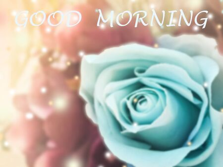 sweet dreamy and de-focused , Good morning word on vintage background  bouquet of blue roses with flare light