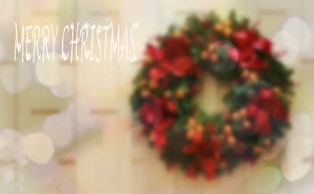 de-focused  , Merry Christmas message on Bokeh background and christmas olive wreath