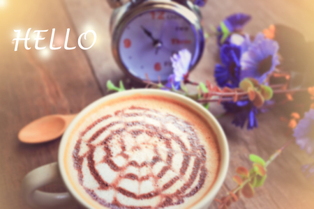 sweet dreamy and de-focused , HELLO word on vintage background coffee latte art and watch on wooden table Stock Photo