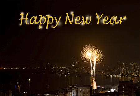 text Happy New Year on Background of fireworks night scene with cityscape sea beach view