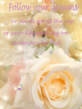 Inspirational motivating quote on sweet dreamy and soft focus background , blooming of  yellow beige rose Stock Photo