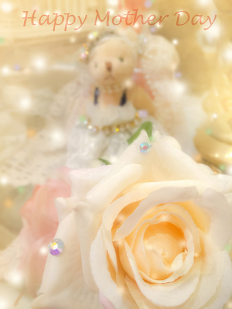 Word Happy mother day on sweet dreamy and soft focus background , blooming of  yellow beige rose Stock Photo
