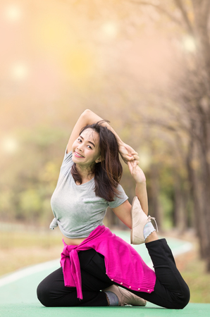 Beautiful mature woman posing in yoga asana at nature garden. Relax and active lifestyle concept ,  soft focus in vintage tone Stock Photo